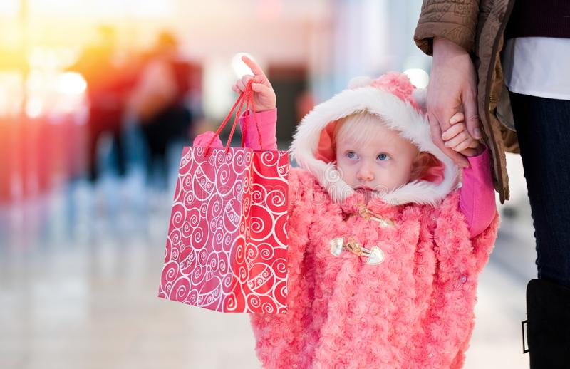 Little baby shopping for gifts in the mall, shopping center . stock images