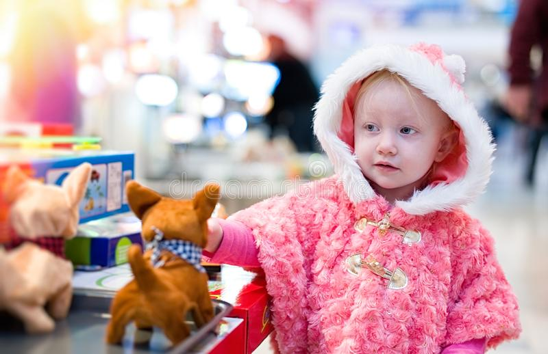 Little baby shopping for gifts in the mall, shopping center . royalty free stock photography