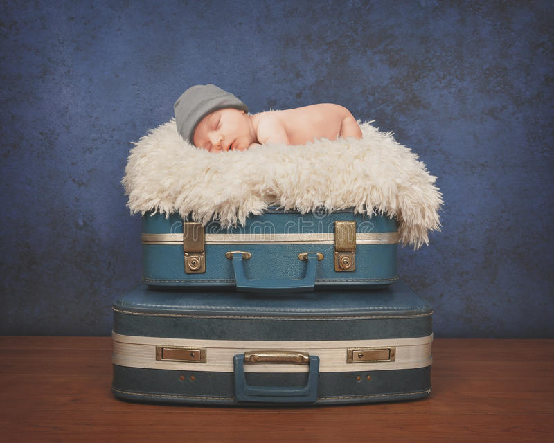 Little Baby Sleeping on Suitcase royalty free stock photo