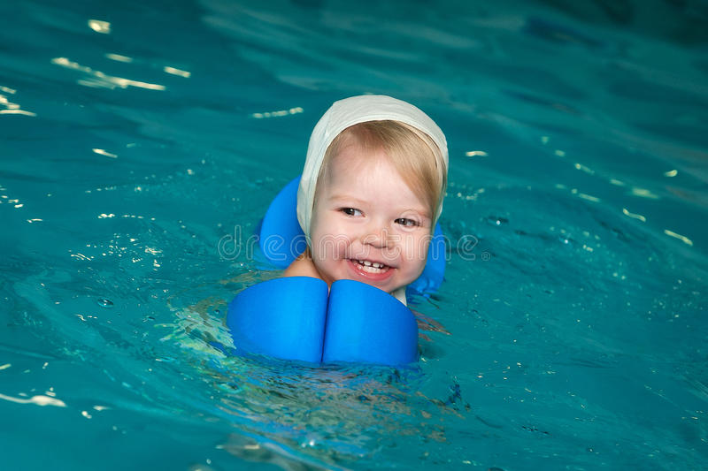 Little baby swimming in water. Little beautiful baby swimming in water stock photos