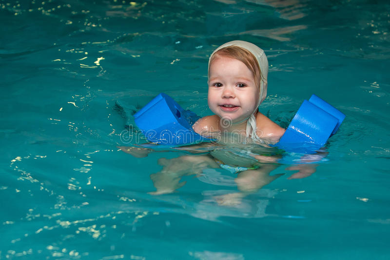Little baby swimming in water. Little baby swimming in deep water stock photos