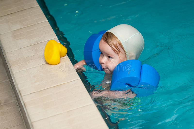 Little baby swimming in water. Little baby swimming in deep water royalty free stock images
