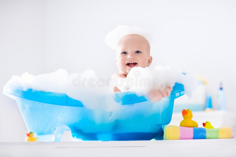 Little baby taking a bath royalty free stock photography