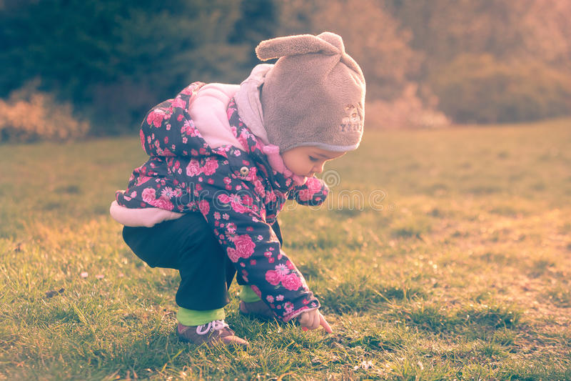 Little baby toddler exploring cold outside world. In the evening royalty free stock photos