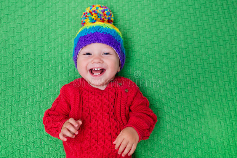 Little baby in warm knitted hat royalty free stock photo