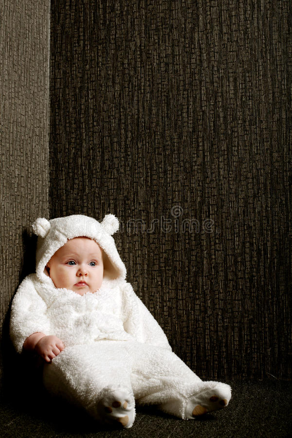 Little baby in white bear costume royalty free stock images