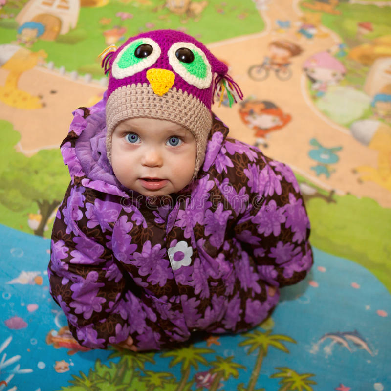 Little baby in winter clothes stock image