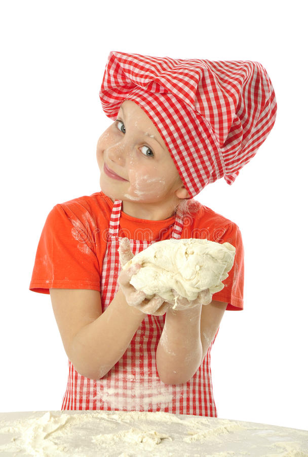 Little baker. Little girl making bread dough royalty free stock photos