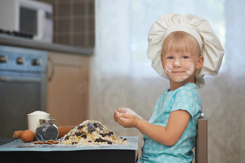 Little baker at work place stock images