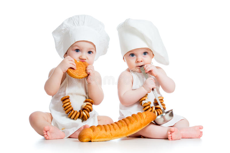 Little cooks kids boy and girl. Little bakers kids boy and girl stock image