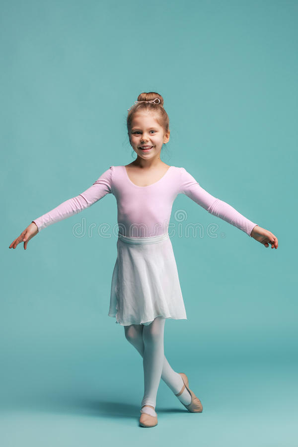The little balerina dancer on blue background royalty free stock image