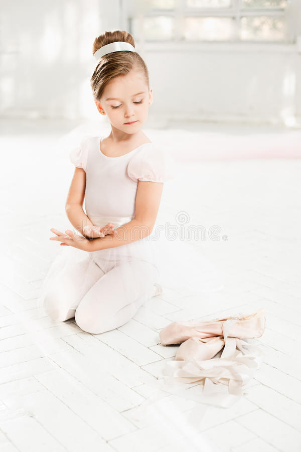The little balerina in white tutu in class at the ballet school royalty free stock photo