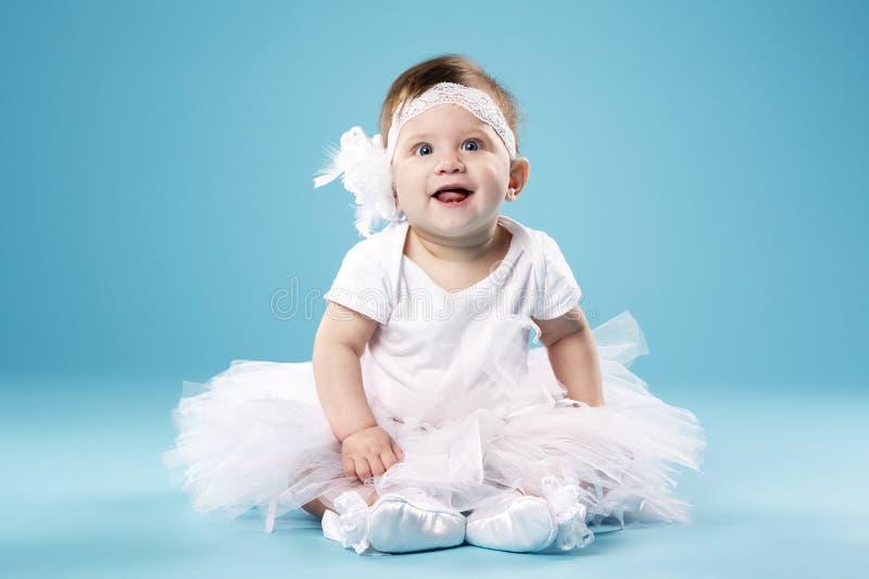 Little ballerina on blue background stock image