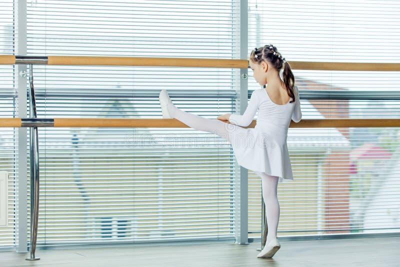 Little ballerina girl. Adorable child dancing classical ballet i stock photo