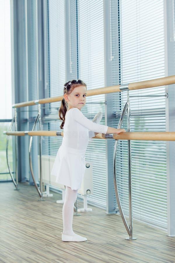Little ballerina girl. Adorable child dancing classical ballet i royalty free stock image