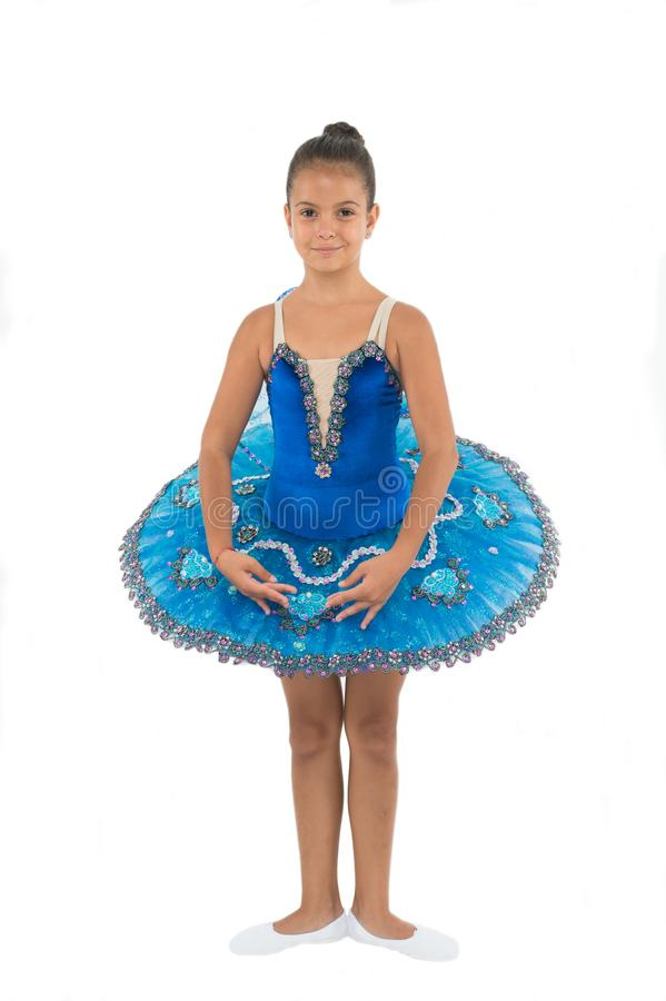 Little ballerina girl in blue tutu. Adorable child in classical ballet position. Little child dance, physical royalty free stock photos