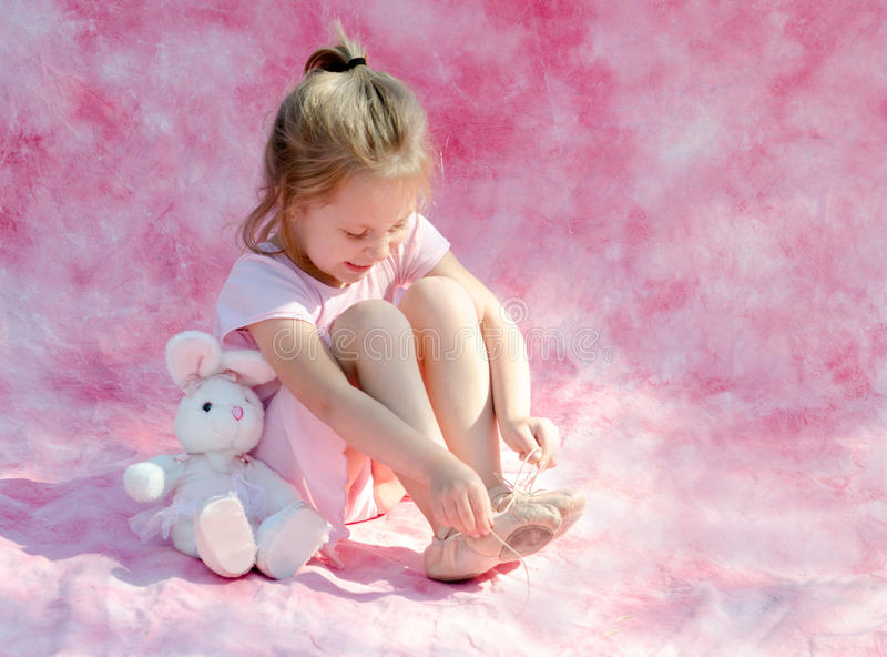 Little ballerina playing stock photo