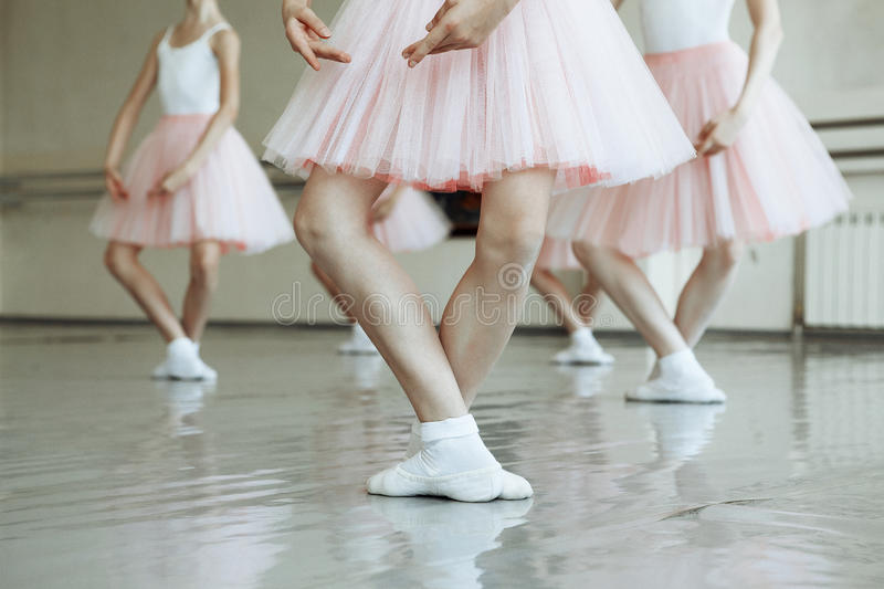Little ballerina`s feet. Little ballerina feet on the point stock photos