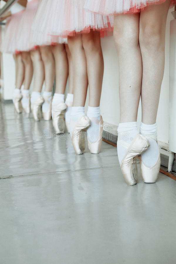 Little ballerina`s feet. Little ballerina feet on the point vertical stock photo