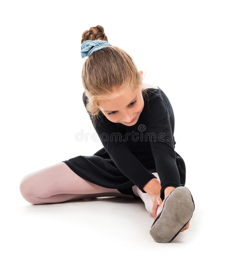 Little ballerina stretching stock photo