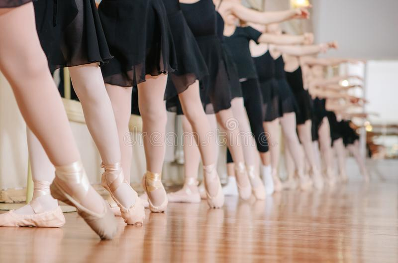 Little ballerinas doing exercises ballet class. royalty free stock photography
