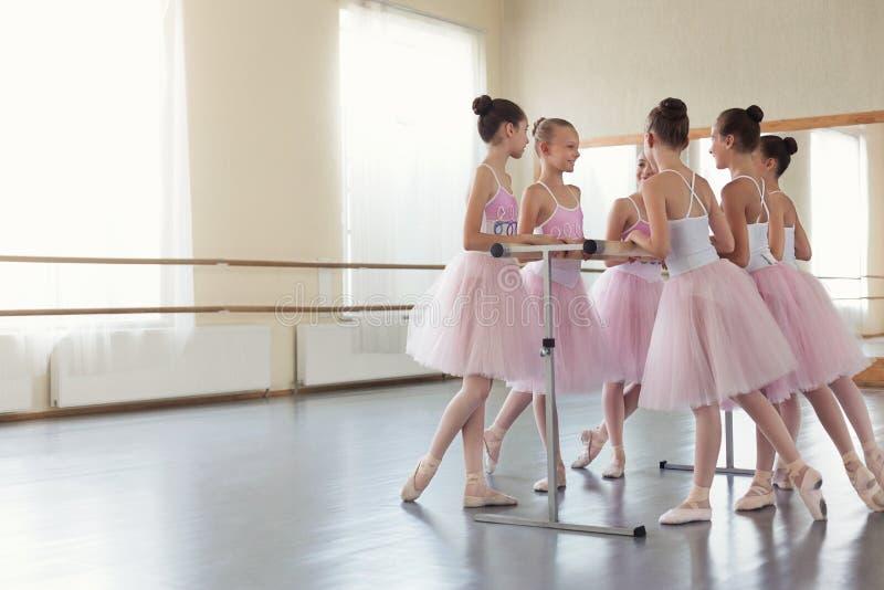 Little ballerinas having break in practice, copy space stock photos