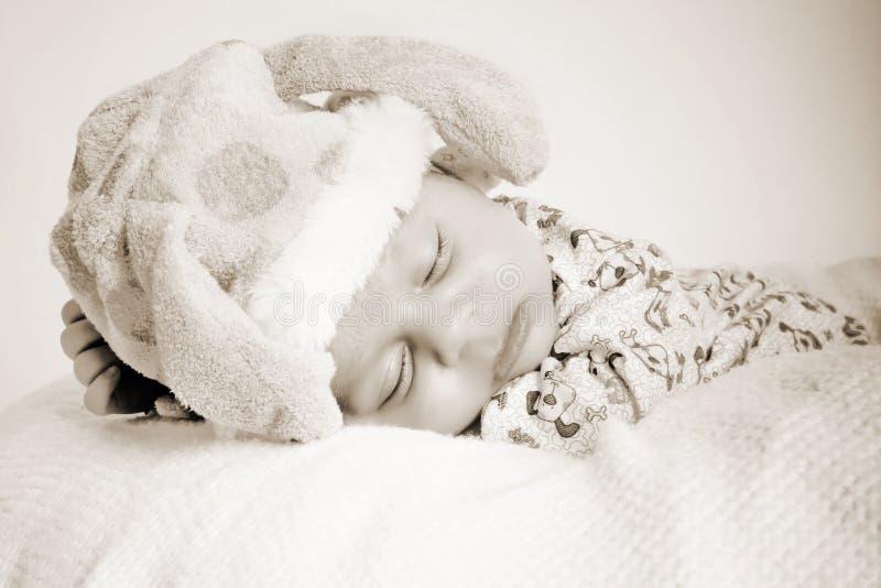 Little bear. New born baby fast asleep on a bean bag stock image