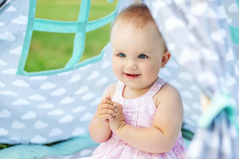 Little beautiful baby on a picnic. Concept of children, childhoo royalty free stock image