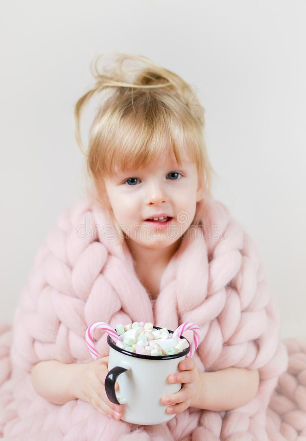 Little Beautiful Caucasian Girl Holding Cup with Hot Chocolate Waiting for Christmas and New Year, Merino Woolen Blanket Pastel Pi stock images