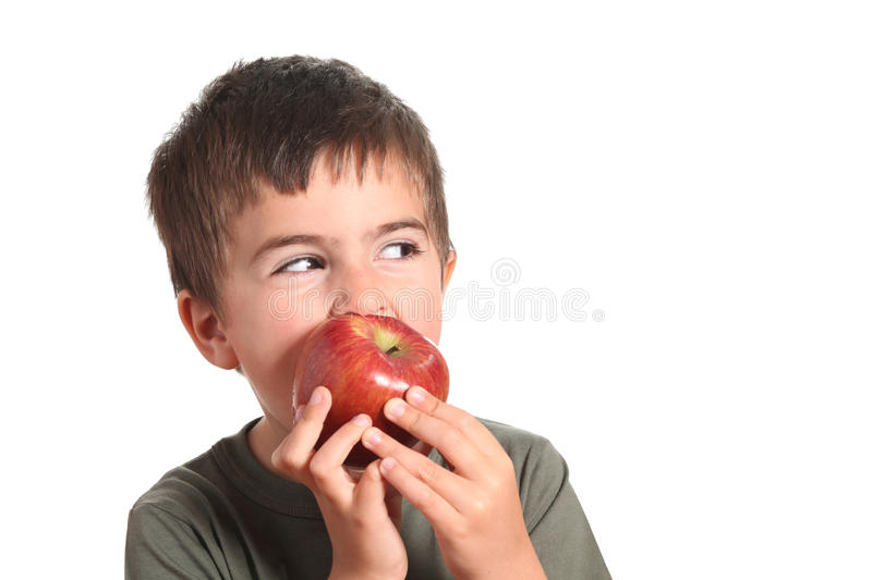 Little beautiful child playing and eating an apple stock image