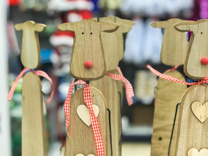 Little beautiful Christmas toy decorative wooden cute festive New Year`s deer with red noses. The background stock images