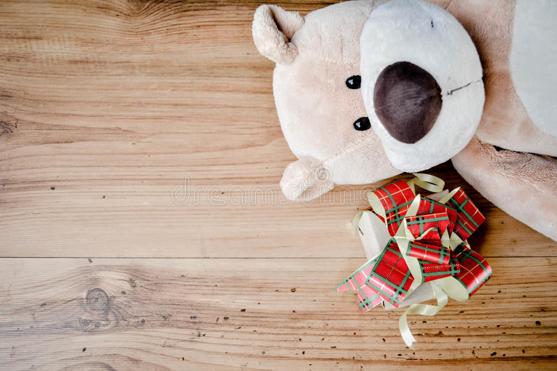 Little beautiful gift box with teddy bear on wood background , v royalty free stock photo