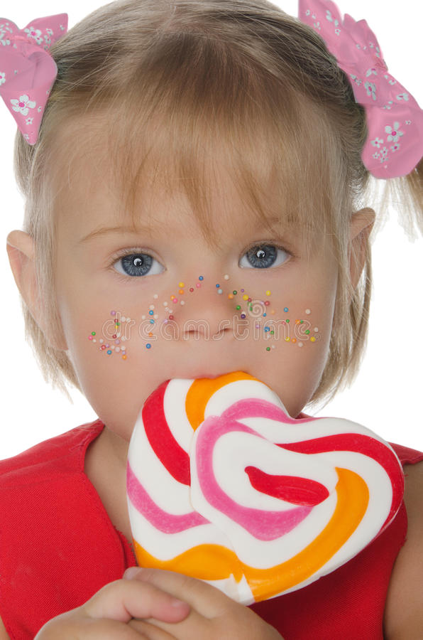 Little beautiful girl with colored Lollipop. Isolated in white royalty free stock image