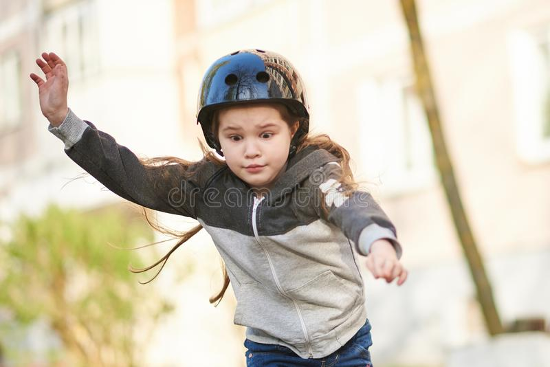 Little beautiful girl falls off a skateboard. For any purpose stock images