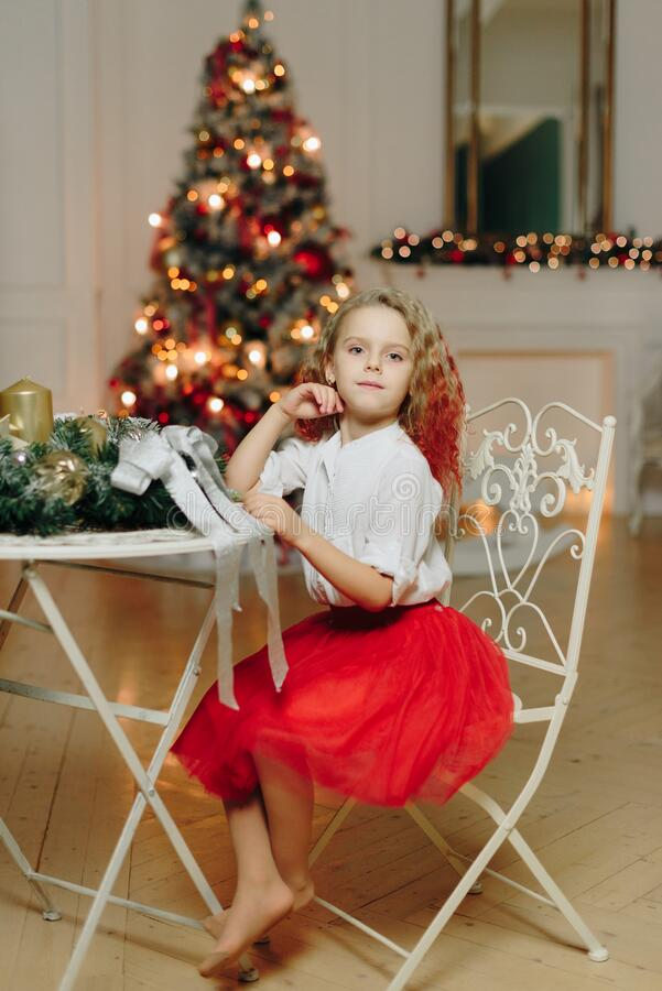 Free Little Beautiful Girl On The Background Of A Decorated Christmas Tree With Lights Royalty Free Stock Photo - 169484525