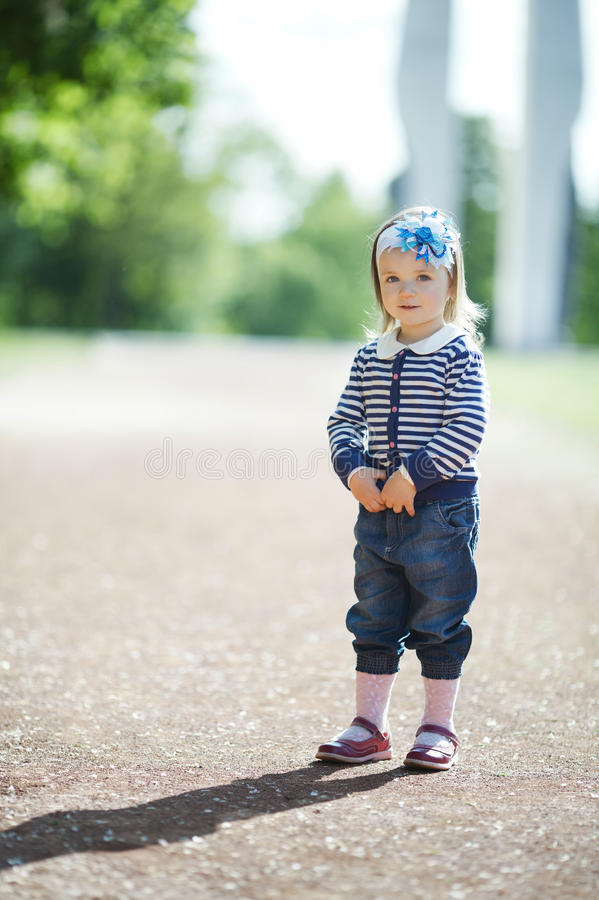 Little beautiful girl portrait. In summer park royalty free stock images