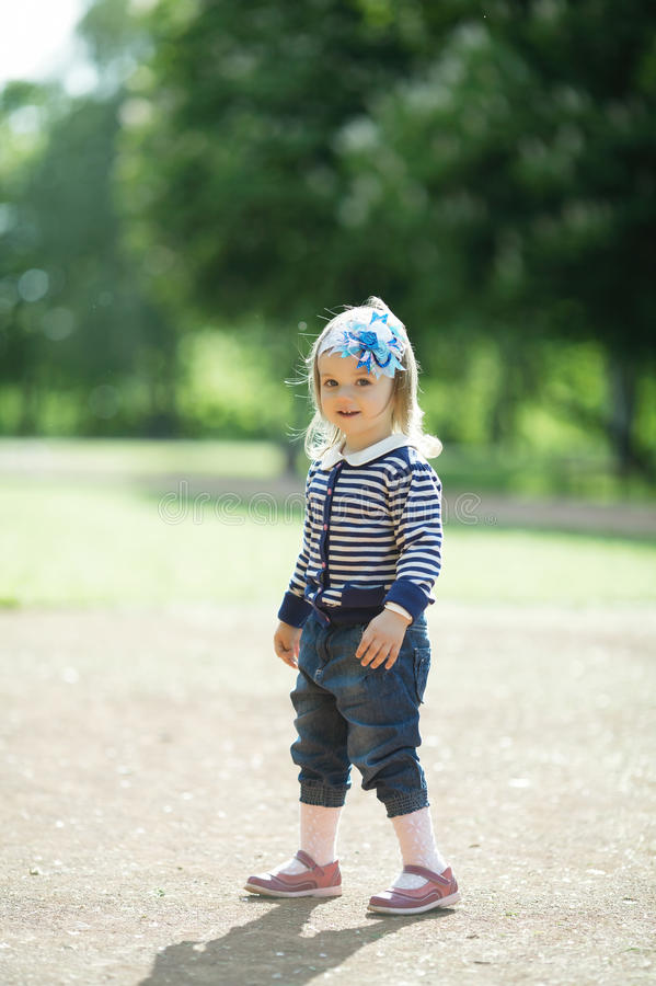 Little beautiful girl portrait. In park royalty free stock photo