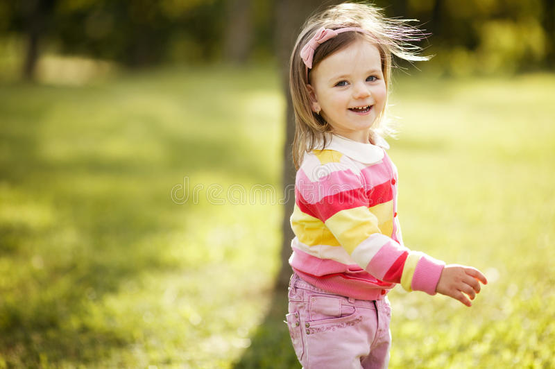 Little beautiful girl portrait. In park stock images
