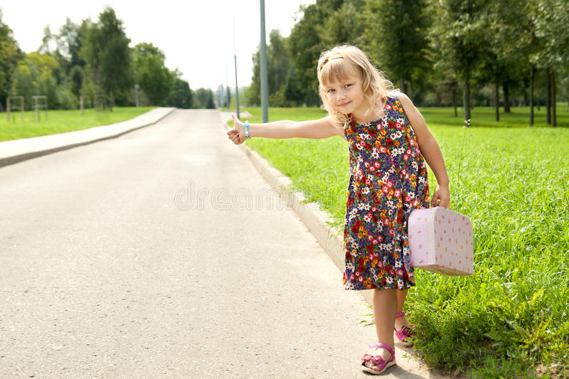 Little beautiful girl on the road royalty free stock images