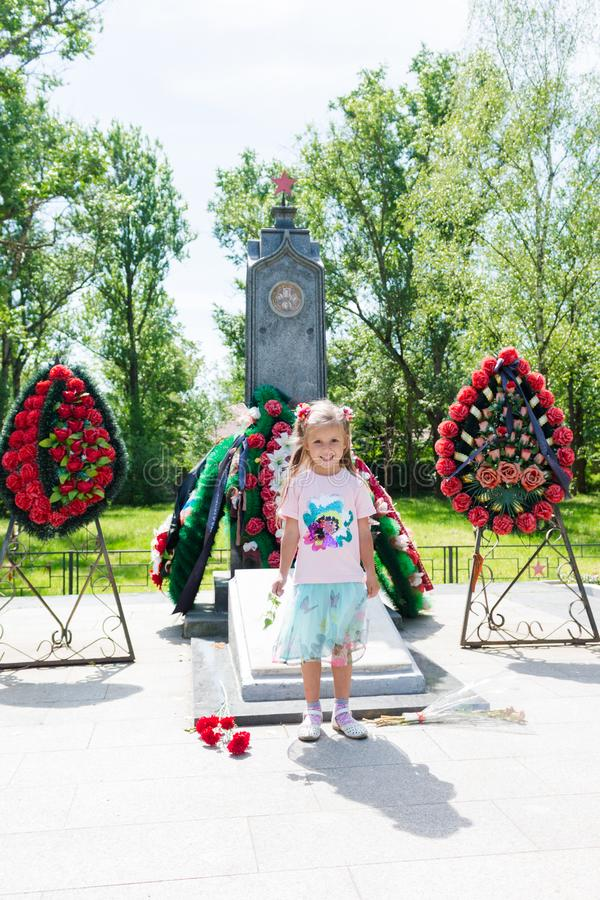 Little beautiful girl standing near the monument royalty free stock photos