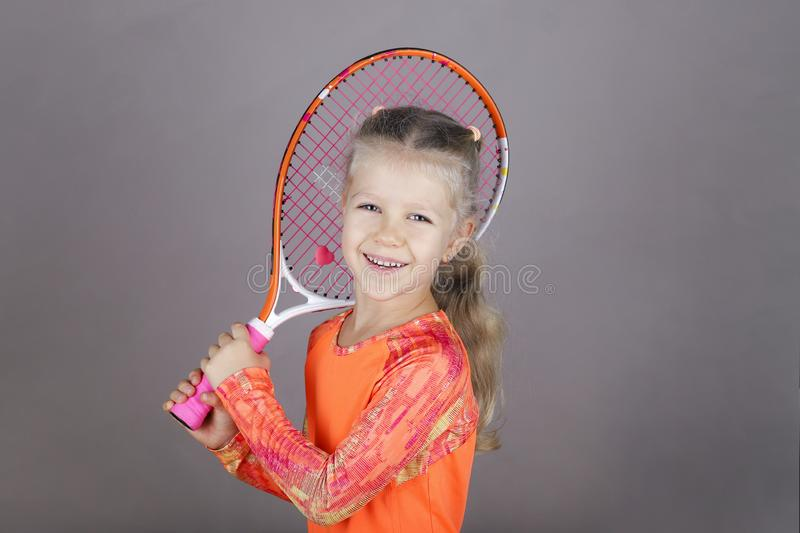 Little beautiful girl with a tennis racket stock photo