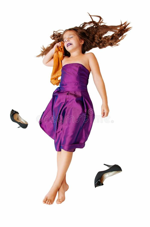 Little beautiful glamor girl in a beautiful evening lilac dress, with long hair with high-heeled shoes, isolate on white royalty free stock photography