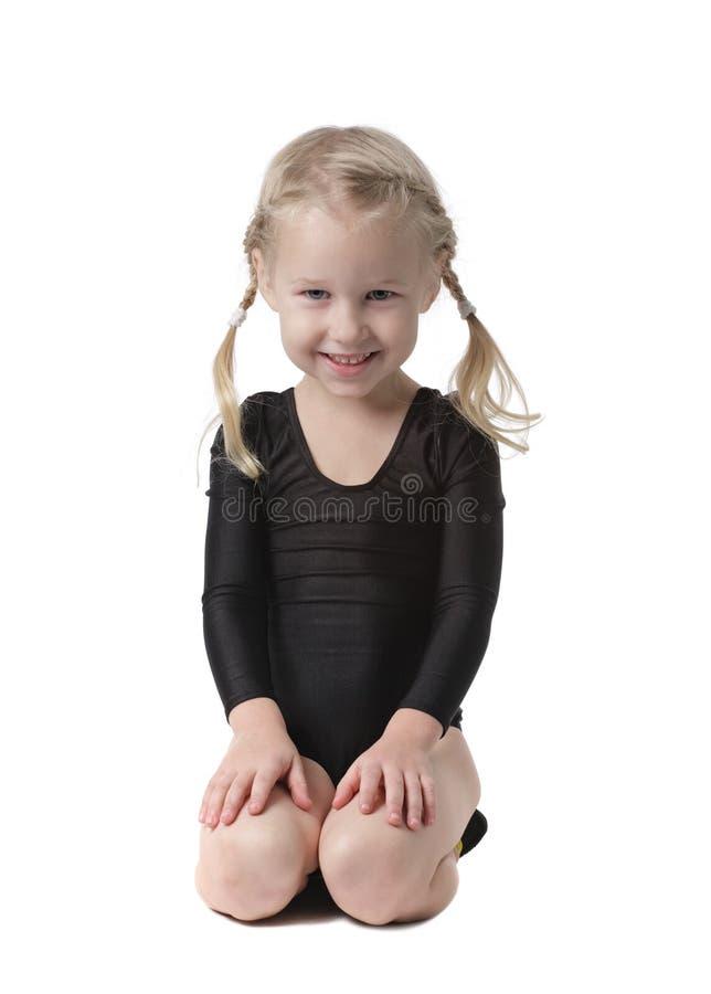 Little beautiful gymnast girl stock photos