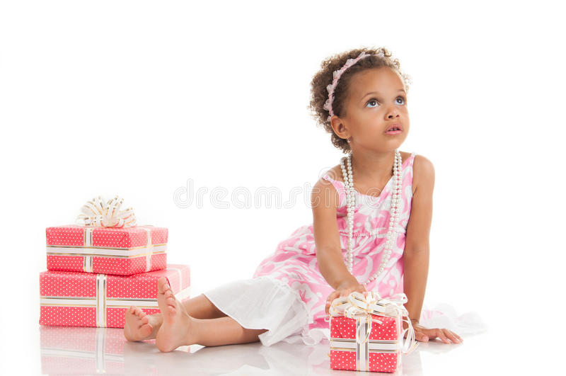 Download Little Beautiful Mulatto Girl With Gifts Stock Photo - Image: 34373632