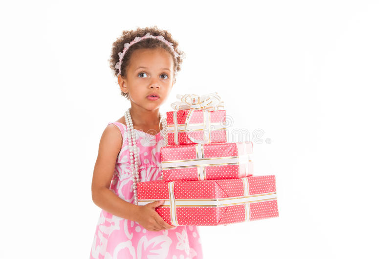 Little Beautiful Mulatto Girl With Gifts. Stock Image