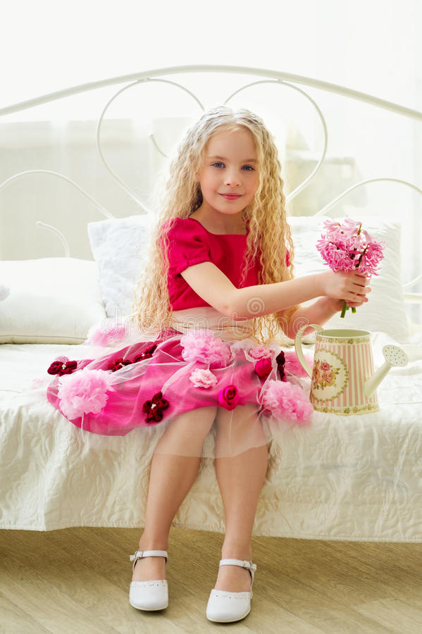 Little beauty in a stunning pink dress stock photography