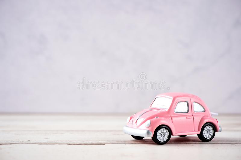 Little beetle pink car in blank background for text, Valentine`s Day concept, Mother`s Day concept, macro shot. stock photos