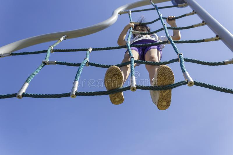 Little beginner school girl playing at playground royalty free stock photography