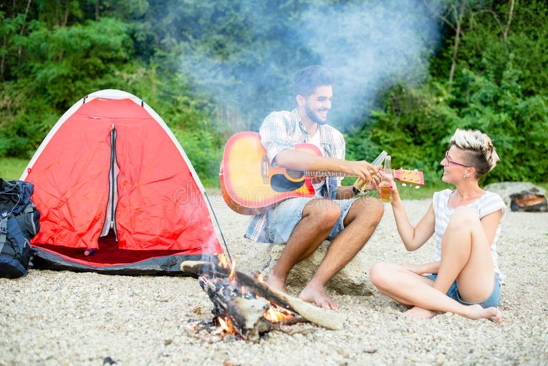Little bit of lovers quality time. Camping on beach stock photo