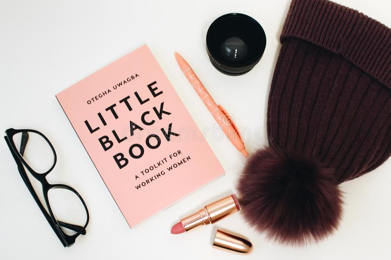 Little Black Book Beside Eyeglasses and Lipstick Case royalty free stock images